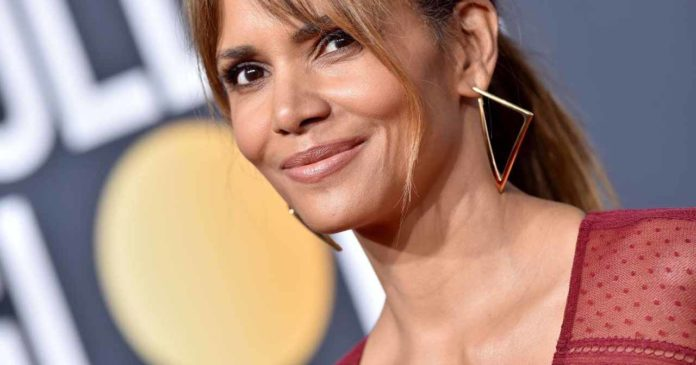 With a wet shirt from the bed, Halle Berry boasts her figure at 53